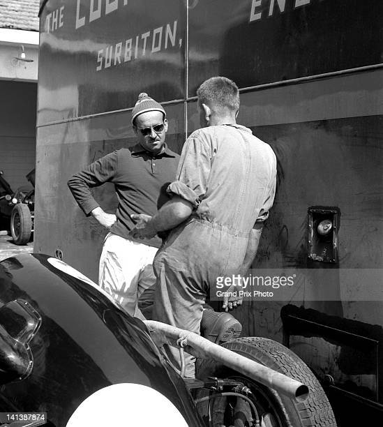Maurice Trintignant of France driver of the Rob Walker Racing Team Cooper T45 Climax Straight4 talking with chief mechanic Alf Francis in the pits...