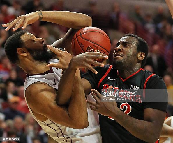 Maurice Walker of the Minnesota Golden Gophers and DJ Foreman of the Rutgers Scarlet Knights batle for a rebound during the first round of the 2015...