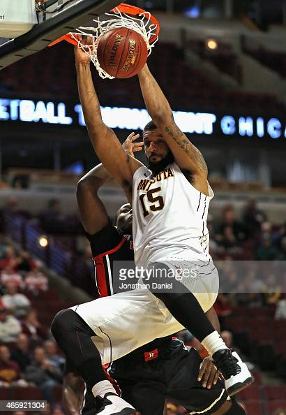 Maurice Walker of the Minnesota Golden Gophers dunks over Shaquille Doorson of the Rutgers Scarlet Knights during the first round of the 2015 Big Ten...