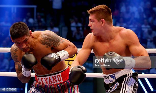 Mauriciio Reynoso of Peru exchange punches with Vincent Feigenbutz of Germany during the WBA interim super middleweight championship fight at Gerry...