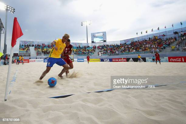 Mauricinho of Brazil battles for the ball with Be Martins of Portugal during the FIFA Beach Soccer World Cup Bahamas 2017 quarter final match between...