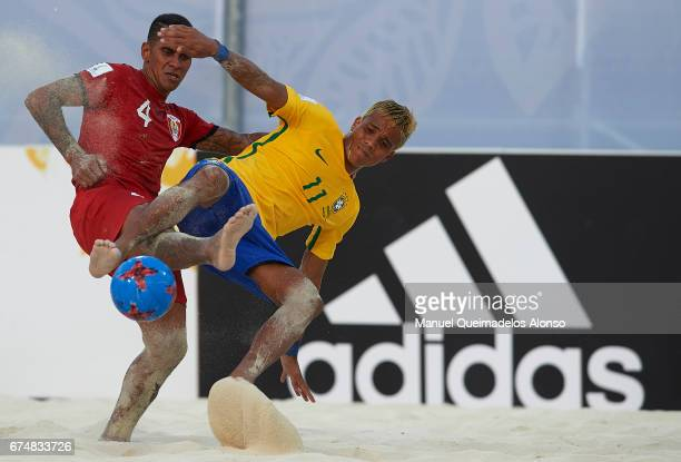 Mauricinho of Brazil competes for the ball with Heimanu Taiarui of Tahiti during the FIFA Beach Soccer World Cup Bahamas 2017 group D match between...