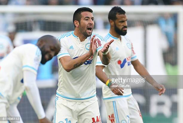 Mauricio Anibal Isla Isla of OM reacts during the French Ligue 1 match between Olympique de Marseille and AS SaintEtienne at New Stade Velodrome on...