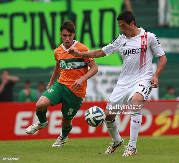 Mauricio Carrasco of Estudiantes struggles for the ball with Nicolás Tagliafico of Banfield during a match between Banfield and Estudiantes as part...