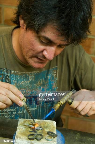 Mauricio Chiavarino at work on a new jewellery piece in his Hakuna Matata jewellery boutique, Calle Calatrava 4.
