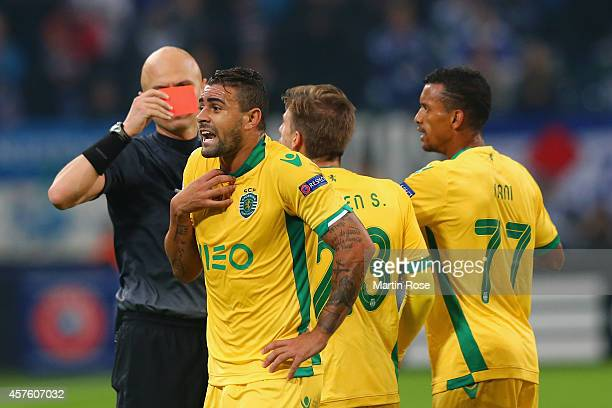 Mauricio Dos Santos Nascimento of Sporting Lisbon reacts as Referee Sergey Karasev shows him a red card during the UEFA Champions League Group G...