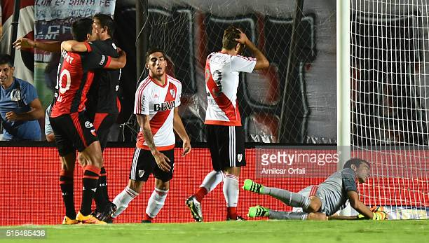 Mauricio Ezequiel Espertudi of Colon celebrates with Alan Ruiz after scoring the second goal of his team during a match between Colon and River Plate...