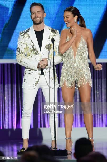 Mauricio Henao and Zuleyka Rivera on stage at Telemundo's 2017 'Premios Tu Mundo' at American Airlines Arena on August 24 2017 in Miami Florida