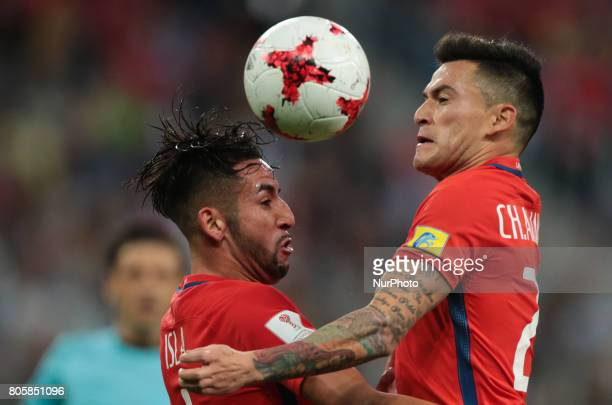 Mauricio Isla Charles Aranguiz of the Chile national football team vie for the ball during the 2017 FIFA Confederations Cup final match between Chile...
