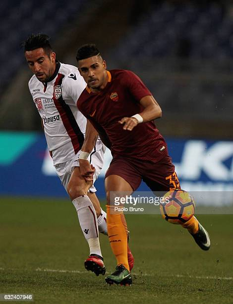Mauricio Isla of Cagliari Calcio competes for the ball with Emerson of AS Roma during the Serie A match between AS Roma and Cagliari Calcio at Stadio...