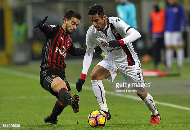 Mauricio Isla of Cagliari Calcio competes for the ball with Suso of AC Milan during the Serie A match between AC Milan and Cagliari Calcio at Stadio...