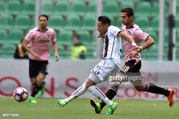 Mauricio Isla of Cagliari is challenged by Ivaylo Chochev of Palermo during the Serie A match between US Citta di Palermo and Cagliari Calcio at...