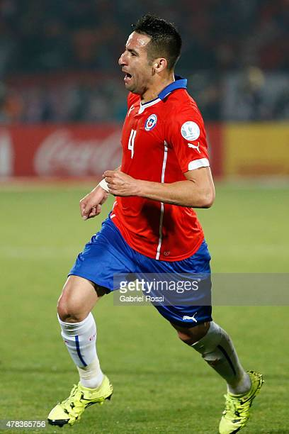 Mauricio Isla of Chile celebrates after scoring the opening goal during the 2015 Copa America Chile quarter final match between Chile and Uruguay at...
