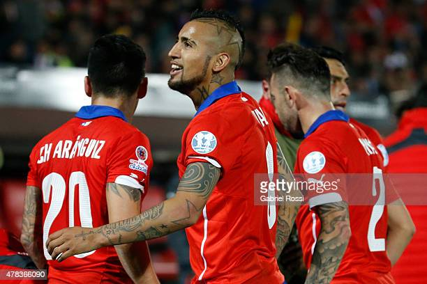 Mauricio Isla of Chile celebrates with teammates after scoring the opening goal during the 2015 Copa America Chile quarter final match between Chile...