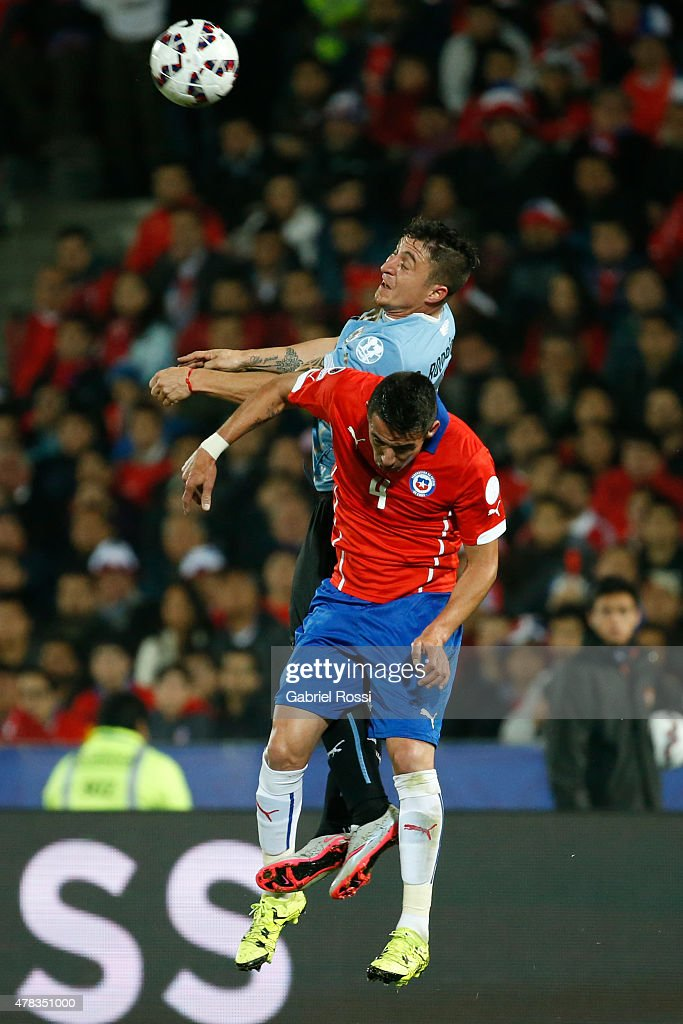 <a gi-track='captionPersonalityLinkClicked' href=/galleries/search?phrase=Mauricio+Isla&family=editorial&specificpeople=4113867 ng-click='$event.stopPropagation()'>Mauricio Isla</a> of Chile goes for a header with Cristian Rodriguez of Uruguay during the 2015 Copa America Chile quarter final match between Chile and Uruguay at Nacional Stadium on June 24, 2015 in Santiago, Chile.