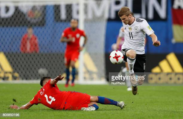 Mauricio Isla of Chile national team and Timo Werner of Germany national team vie for the ball during FIFA Confederations Cup Russia 2017 final match...
