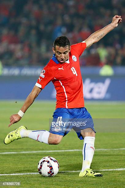 Mauricio Isla of Chile shoots to score the opening goal during the 2015 Copa America Chile quarter final match between Chile and Uruguay at Nacional...