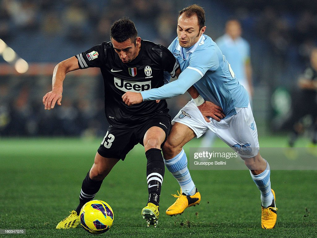 <a gi-track='captionPersonalityLinkClicked' href=/galleries/search?phrase=Mauricio+Isla&family=editorial&specificpeople=4113867 ng-click='$event.stopPropagation()'>Mauricio Isla</a> of Juventus and <a gi-track='captionPersonalityLinkClicked' href=/galleries/search?phrase=Stefan+Radu&family=editorial&specificpeople=4050253 ng-click='$event.stopPropagation()'>Stefan Radu</a> of Lazio in action during the TIM cup match between S.S. Lazio and Juventus FC at Stadio Olimpico on January 29, 2013 in Rome, Italy.