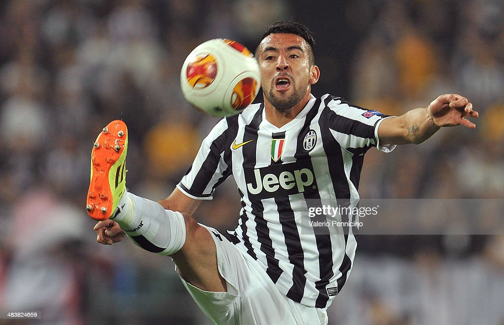 Mauricio Isla of Juventus controls the ball durig the UEFA Europa League quarter final match between Juventus and Olympique Lyonnais at Juventus Arena on April 10, 2014 in Turin, Italy.