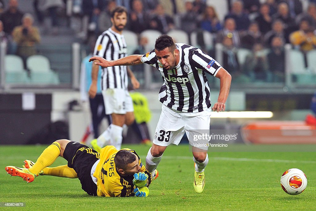<a gi-track='captionPersonalityLinkClicked' href=/galleries/search?phrase=Mauricio+Isla&family=editorial&specificpeople=4113867 ng-click='$event.stopPropagation()'>Mauricio Isla</a> (R) of Juventus is tackled by Anthony Lope s of Olympique Lyonnais durig the UEFA Europa League quarter final match between Juventus and Olympique Lyonnais at Juventus Arena on April 10, 2014 in Turin, Italy.