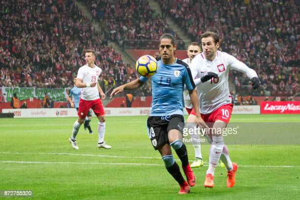 Mauricio Lemos and Grzegorz Krychowiak during the international friendly soccer match between Poland and Uruguay at the PGE National Stadium in...