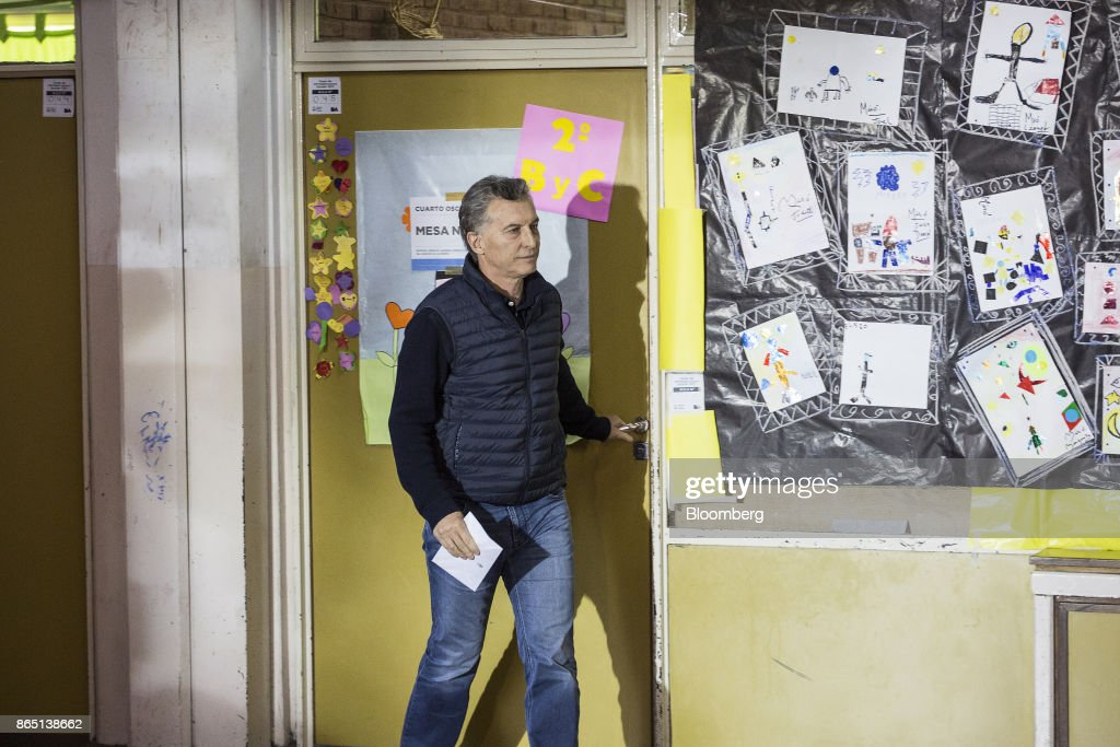 Mauricio Macri, Argentina's president, exits a voting booth before casting a ballot at a polling station in Buenos Aires, Argentina, on Sunday, Oct. 22, 2017. Argentines will have the opportunity to send a message of support forMacri'sreform agenda as they vote in mid-term elections today after months of intense campaigning.