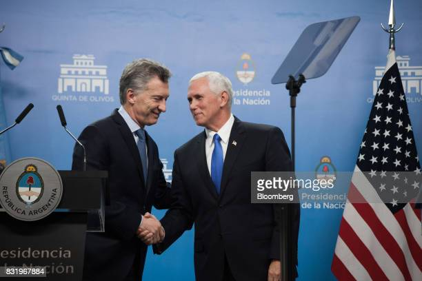 Mauricio Macri Argentina's president left shakes hands with US Vice President Mike Pence during a joint press conference in Buenos Aires Argentina on...