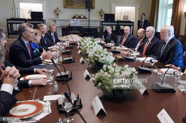 Mauricio Macri Argentina's president left speaks while US President Donald Trump right listens during a luncheon at the White House in Washington DC...