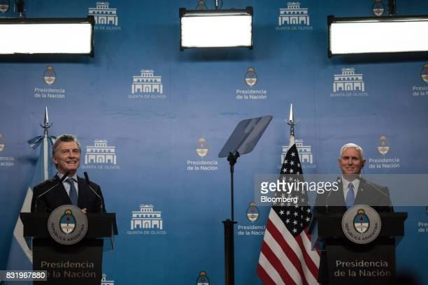 Mauricio Macri Argentina's president left speaks while US Vice President Mike Pence listens during a joint press conference in Buenos Aires Argentina...