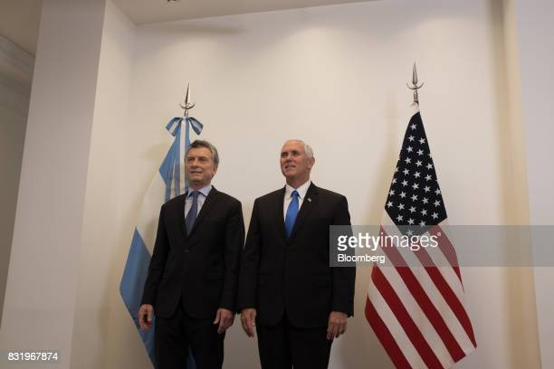Mauricio Macri Argentina's president left stands with US Vice President Mike Pence during a meeting at the presidential residence in Olivos Argentina...
