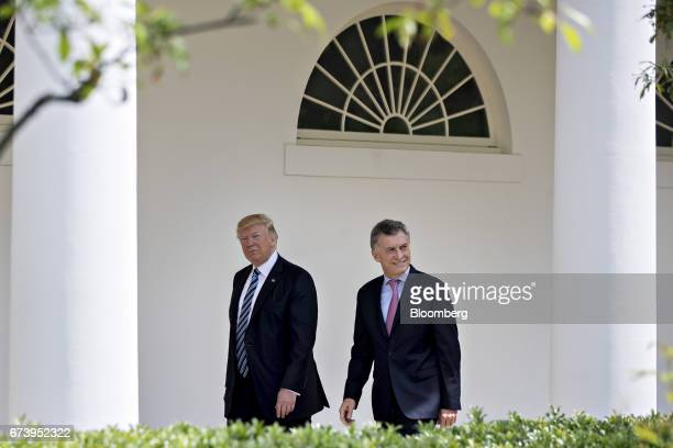 Mauricio Macri Argentina's president right and US President Donald Trump walk through the Colonnade of the White House in Washington DC US on...
