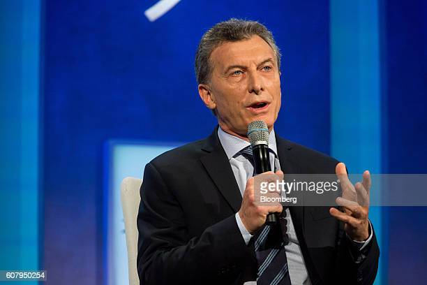 Mauricio Macri president of Argentina center speaks in a panel discussion during the annual meeting of the Clinton Global Initiative in New York US...