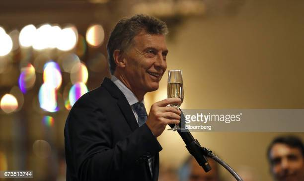 Mauricio Macri president of Argentina gives a toast during a luncheon with oil executives in Houston Texas US on Wednesday April 26 2017 Macrimet...