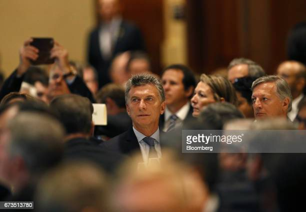 Mauricio Macri president of Argentina listens to a speaker during a luncheon with oil executives in Houston Texas US on Wednesday April 26 2017...
