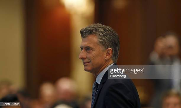 Mauricio Macri president of Argentina walks to the podium to deliver a speech during a luncheon with oil executives in Houston Texas US on Wednesday...