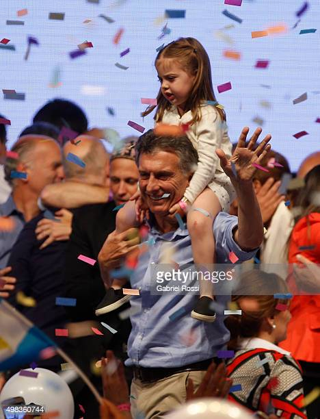 Mauricio Macri Presidential Candidate for Cambiemos carries his daughter on his shoulders after runoff elections at Cambiemos Bunker on November 22...