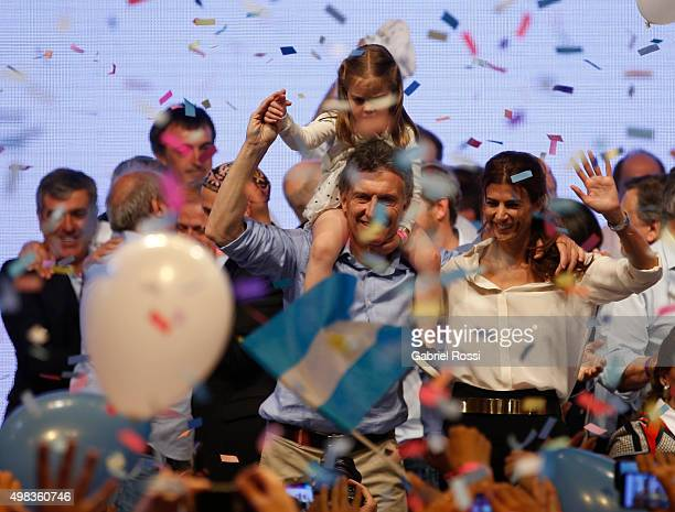 Mauricio Macri Presidential Candidate for Cambiemos carries his daughter on his shoulders as he celebrates with his wife Juliana Awada after runoff...