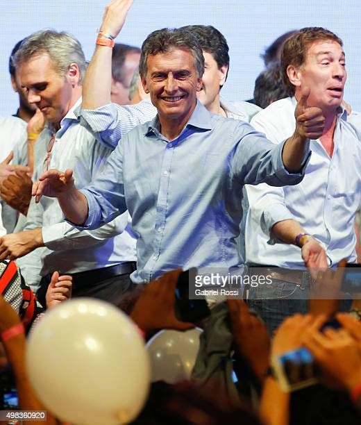 Mauricio Macri Presidential Candidate for Cambiemos gives the 'thumbs up' to supporters after runoff elections at Cambiemos Bunker on November 22...