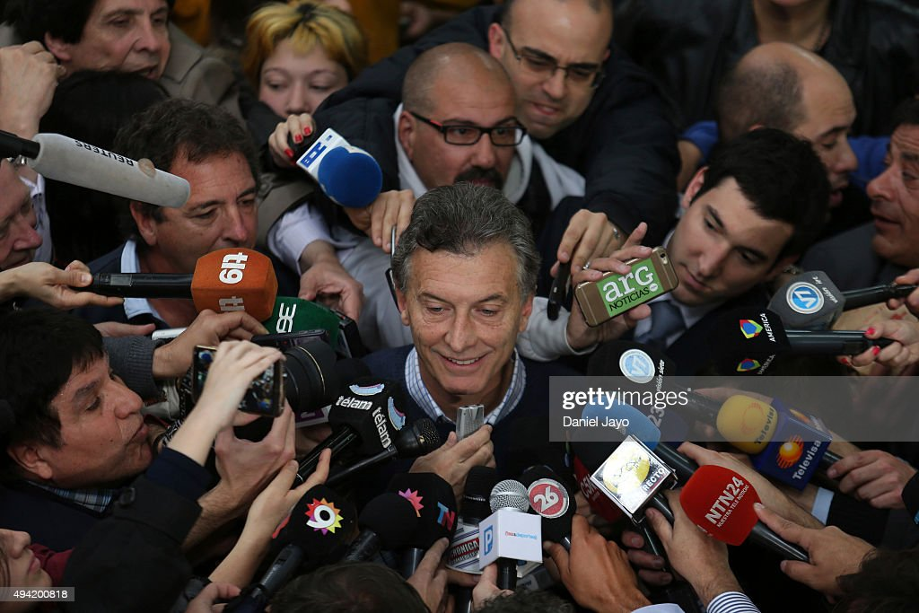 <a gi-track='captionPersonalityLinkClicked' href=/galleries/search?phrase=Mauricio+Macri&family=editorial&specificpeople=773012 ng-click='$event.stopPropagation()'>Mauricio Macri</a>(C) Presidential Candidate for Cambiemos speaks to media members after casting his vote during general elections on October 25, 2015 in Buenos Aires, Argentina.