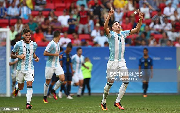 Mauricio Martinez of Argentina celebrates scoring a late goal from a free kick during the Men's First Round Group D match between Argentina and...