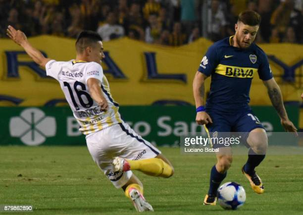 Mauricio Martinez of Rosario Central fights for the ball with Nahitan Nandez of Boca Juniors during a match between Rosario Central and Boca Juniors...