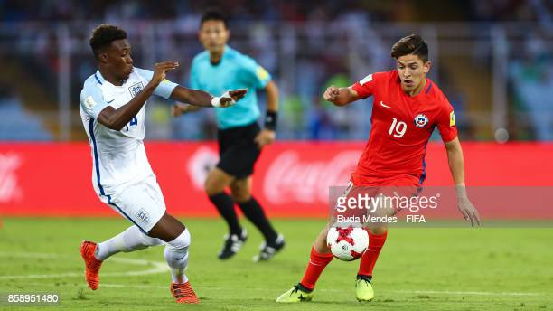 Mauricio Morales of Chile battles for the ball with Callum HudsonOdoi of England during the FIFA U17 World Cup India 2017 group F match between Chile...
