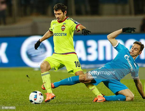 Mauricio of FC Zenit St Petersburg and Alan Dzagoev of PFC CSKA Moscow vie for the ball during the Russian Football League match between FC Zenit St...