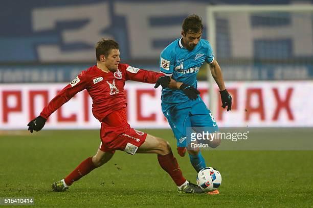 Mauricio of FC Zenit St Petersburg and Ruslan Kambolov of FC Rubin Kazan vie for the ball during the Russian Football League match between FC Zenit...