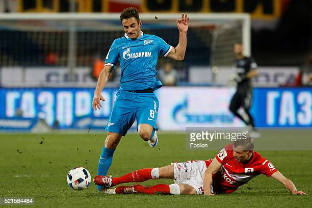 Mauricio of FC Zenit St Petersburg and Yevgeni Makeyev of FC Spartak Moscow vie for the ball during the Russian Football League match between FC...
