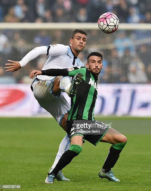 Mauricio of Sassulo and Nicola Sansone of Lazio in action during the Serie A match between US Sassuolo Calcio and SS Lazio at Mapei Stadium Citta del...