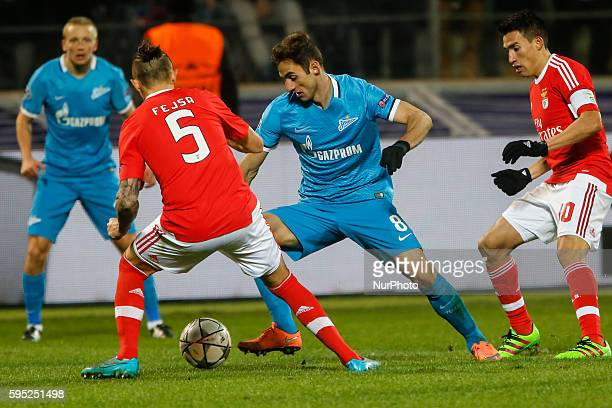 Mauricio of Zenit in action against Ljubomir Fejsa and Nicolas Gaitan of Benfica during the UEFA Champions League Round of 16 second leg match...
