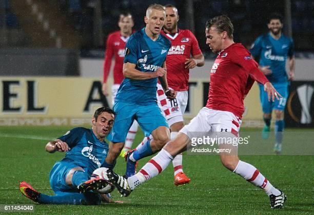 Mauricio of Zenit SaintPetersburg in action with Ben Rienstra of AZ Alkmaar during Europa League Group D football match between Zenit StPetersburg...