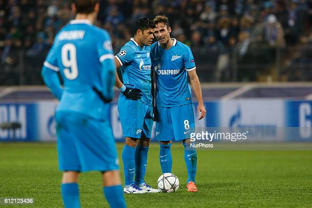 Mauricio of Zenit talks to Hulk during the UEFA Champions League Round of 16 second leg match between FC Zenit St Petersburg and SL Benfica at...