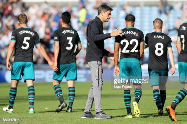 Mauricio Pellegrino Manager of Southampton and Nathan Redmond of Southampton embrace after the Premier League match between Huddersfield Town and...